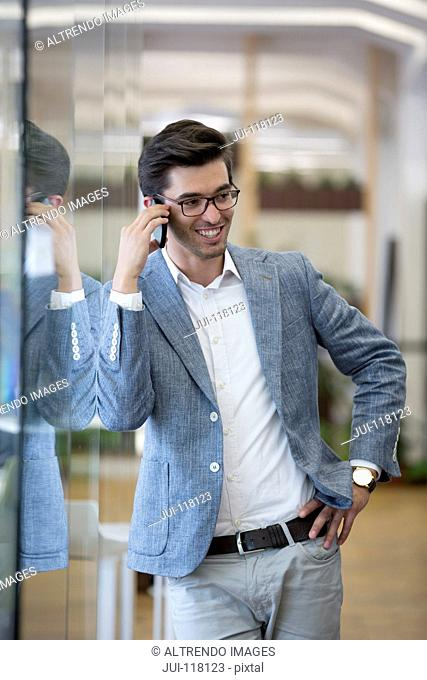 Businessman Making Phone Call In Modern Office