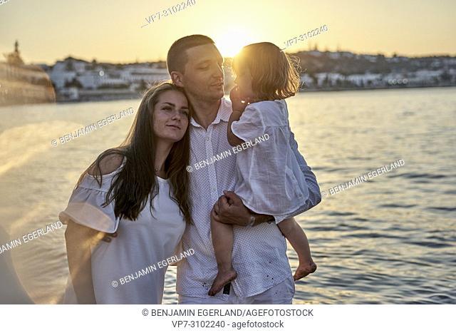 family enjoying togetherness, love, bonding, sunset, at beach, seaside. In Chersonissos, Crete, Greece