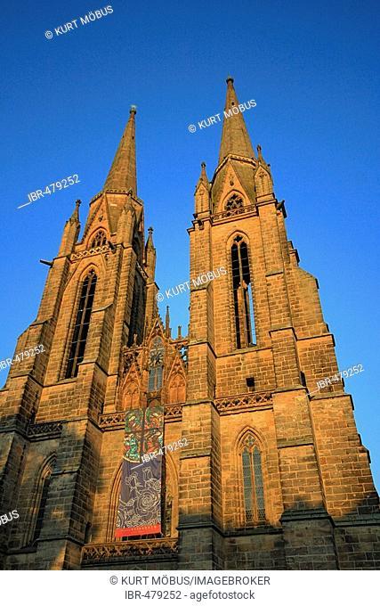 Steeple of Saint Elisabeth Church with poster of Elisabeth exhibiton, Marburg, Hesse, Germany
