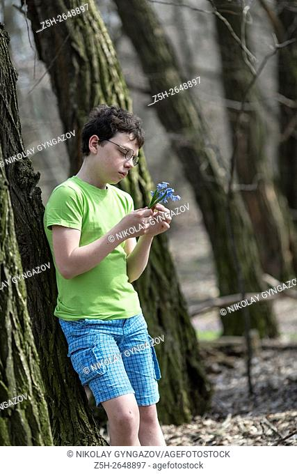 Russia. Teen twelve years in the spring forest