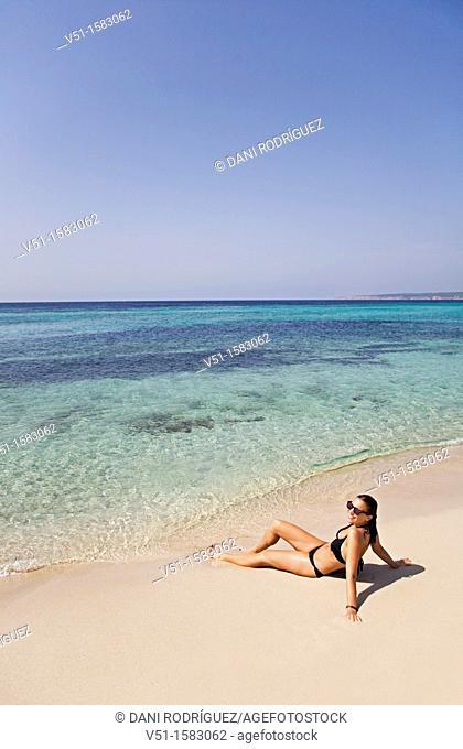 Portrait of a brunette woman relaxing at the beach in Formentera