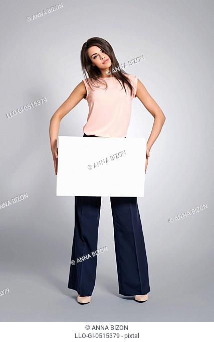 Beautiful woman holding empty whiteboard. Debica, Poland