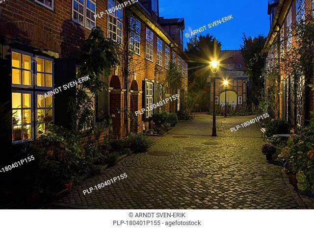 Haasenhof / Haasen Courtyard illuminated at night in the Hanseatic town Lübeck / Luebeck, Schleswig-Holstein, Germany