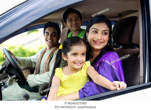 Family sitting inside a car