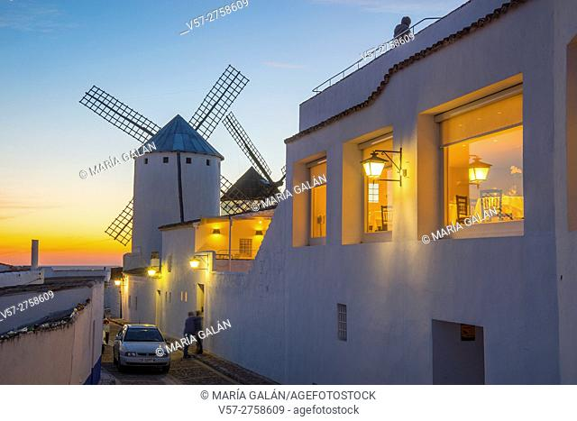 Street and windmills at sunset. Campo de Criptana, Ciudad Real province, Castilla La Mancha, Spain
