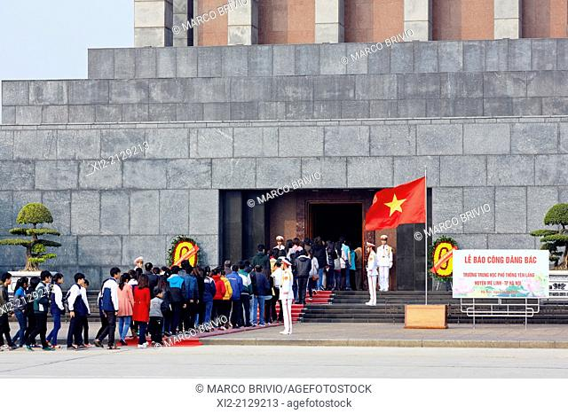 People standing in a queue to visit the Ho Chi Minh Mausoleum in Hanoi, Vietnam