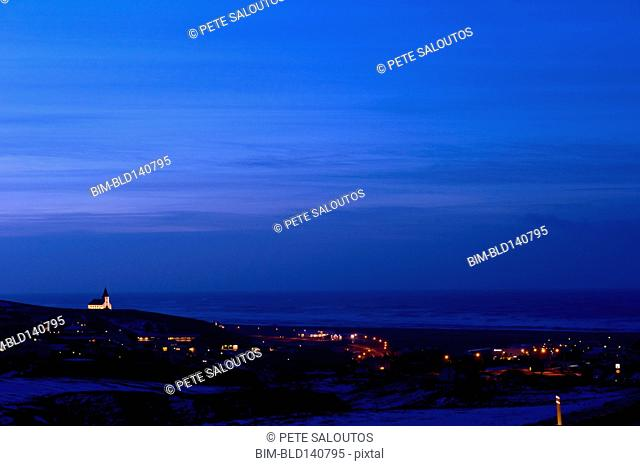 Vik cityscape illuminated at night, Sudhurland, Iceland