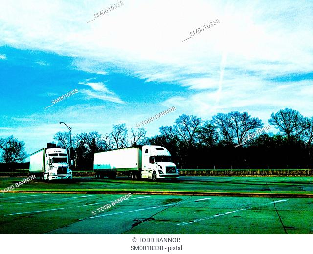 Two semi tractor trailers parked at rest area, Indiana USA