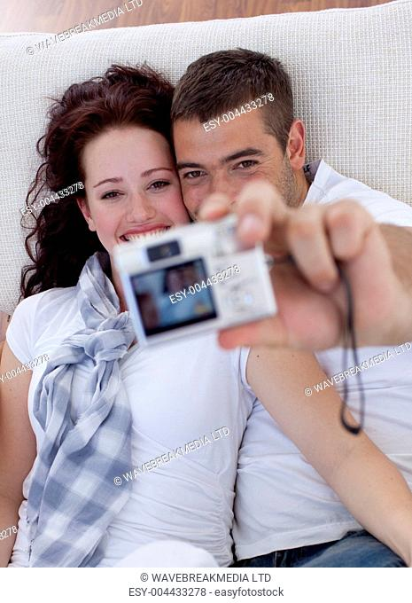 Couple playing with a camera