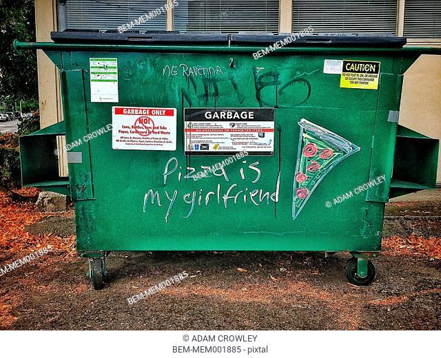 Graffiti on urban dumpster