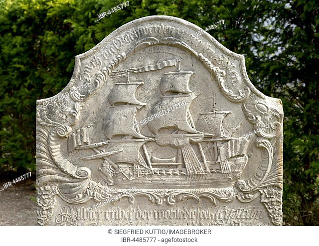 Old grave stone with Sailboat on cemetery, Nebel, Amrum, North Frisia, Schleswig-Holstein, Germany