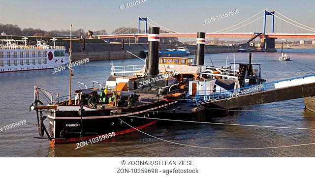 museum ship Oskar Huber and brigde Friedrich-Ebert-Bruecke over the river Rhine, Duisburg, Germany