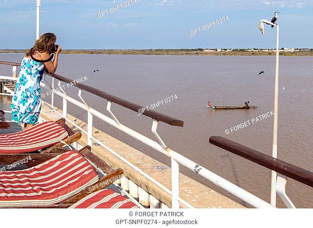 TOURIST PASSENGERS ON THE DECK OF THE BOU EL MOGDAD CRUISE BOAT FROM THE SENEGAL RIVER COMPANY, SENEGAL, WEST AFRICA
