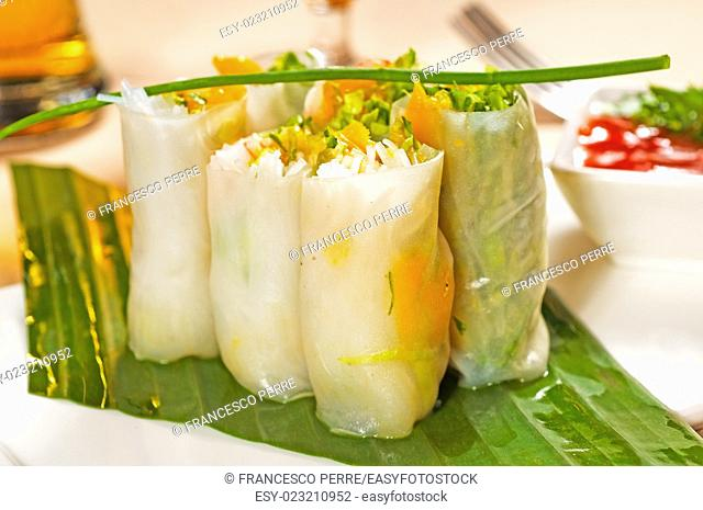 fresh tipycal vietnamese style summer rolls,on a palm leaf