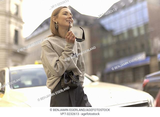 stylish blogger woman at street, streetstyle, in city Munich, Bavaria, Germany