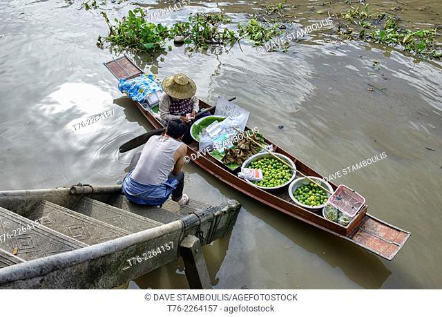 traditional boat vendor at the Amphawa Floating Market, Thailand