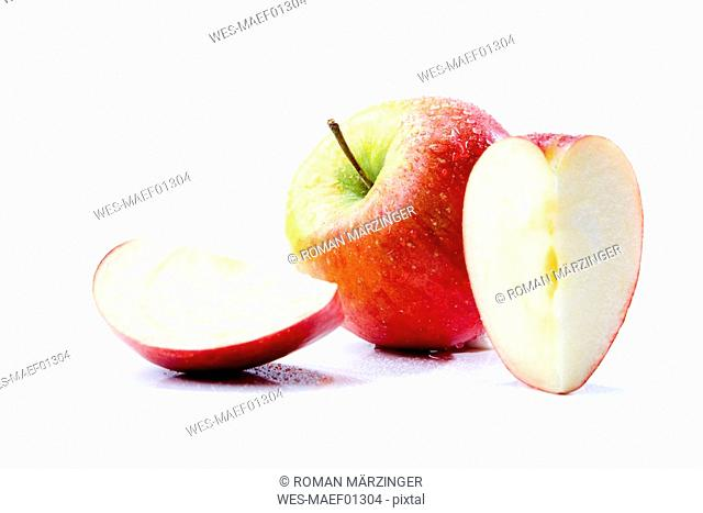 Sliced apple pieces and an apple, close-up
