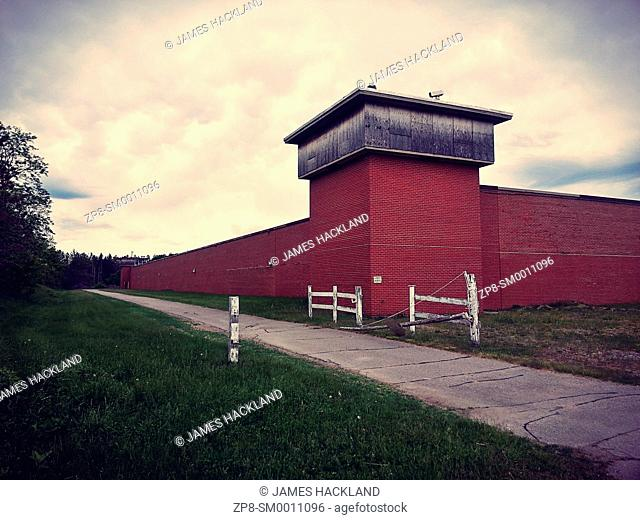 The outer wall of an abandoned maximum security prison. Millbrook, Ontario, Canada