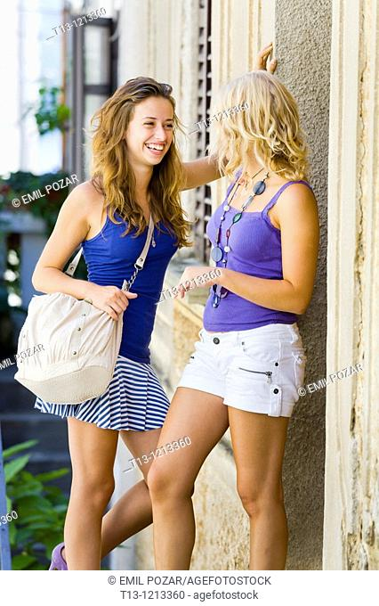 great laugh, two young women together on the street