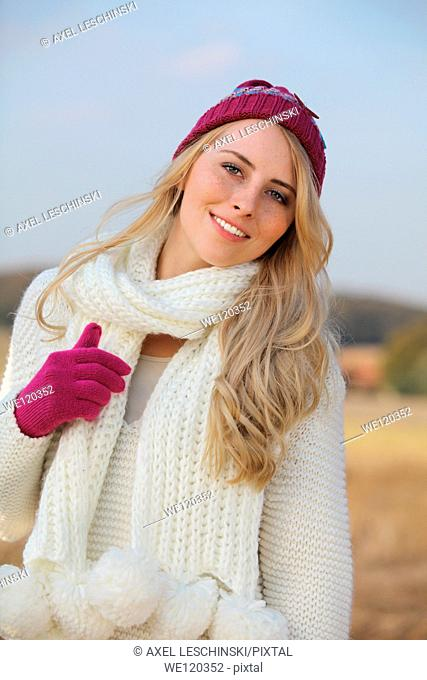 portrait of woman with knit hat and scarf