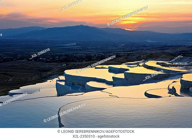 Travertine terraces of Pamukkale at sunset. Denizli Province, Turkey