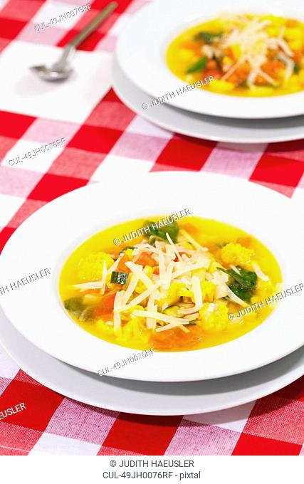 Bowl of minestrone with cheese