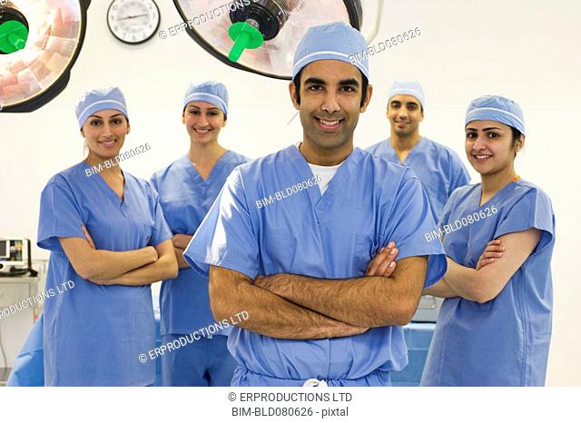 Surgeons smiling in operating room