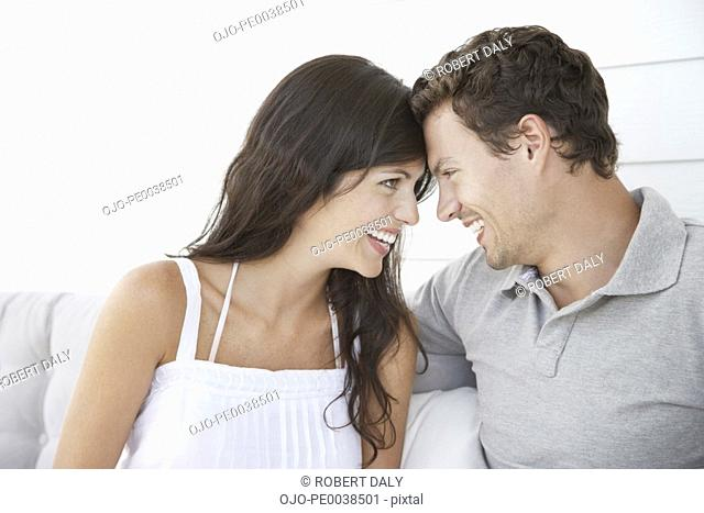 A couple being affectionate by touching foreheads