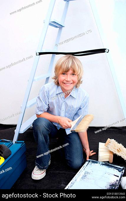 Portrait of little boy renovating home