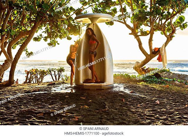 France, Reunion island (French overseas department), Etang Sale, Etang Sale les Bains, Portrait of a young woman Creole under a beach shower