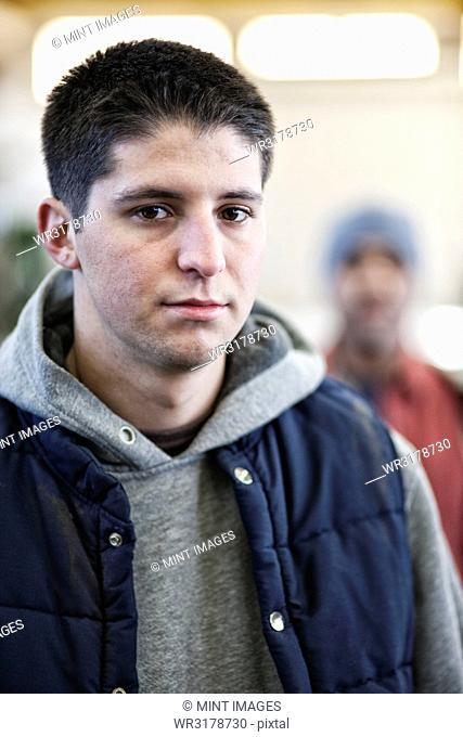 Young Caucasian man factory worker in a sheet metal factory