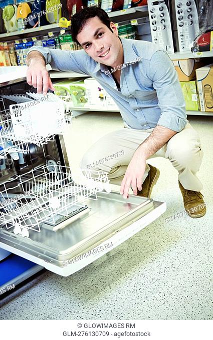 Man buying a dishwasher in a supermarket