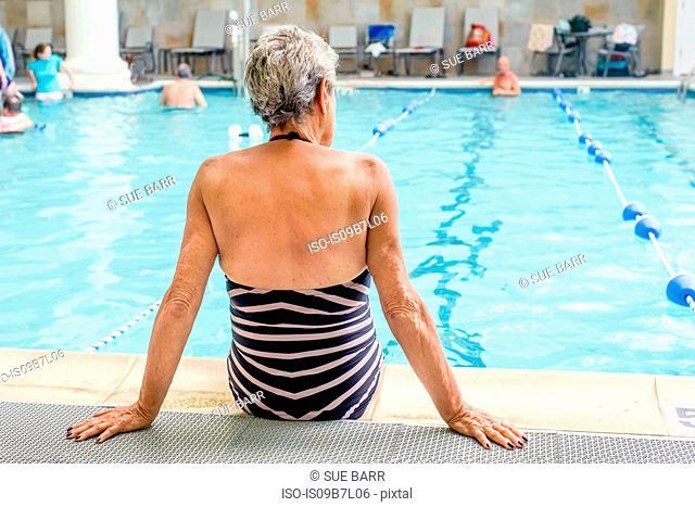 Senior woman by poolside