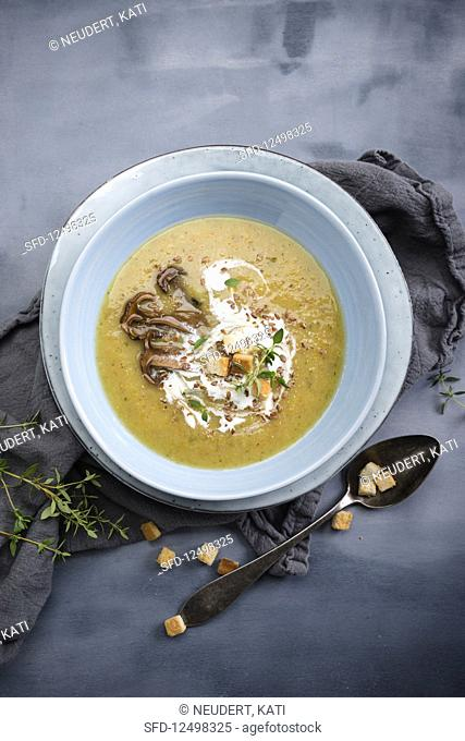 Vegan mushroom and potato soup with croutons and linseed