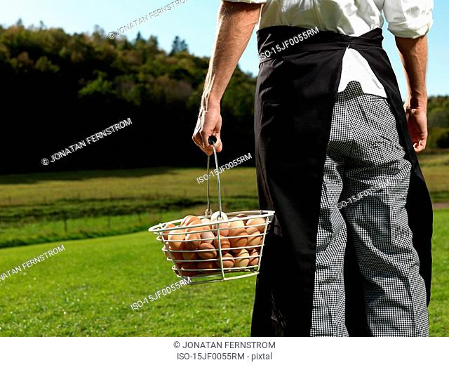 Chef with basket full of eggs