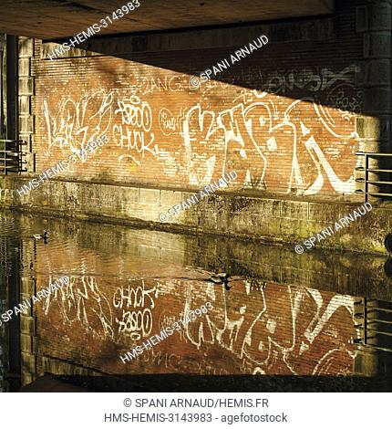 France, Haute Garonne, Toulouse, listed at Great Tourist Sites in Midi-Pyrenees, listed as World Heritage by UNESCO, Midi Channel, graffiti under a canal bridge