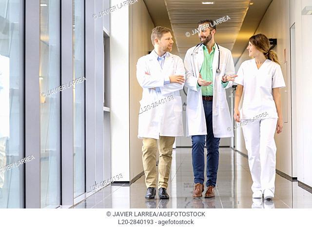 Doctors and nurses walking in corridor, Hospital