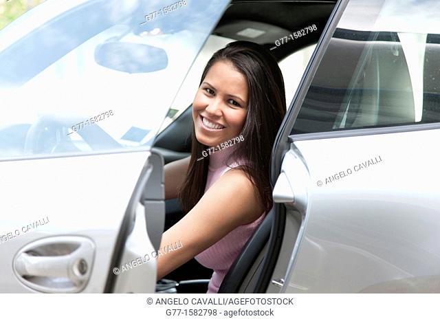 Woman in a sport car