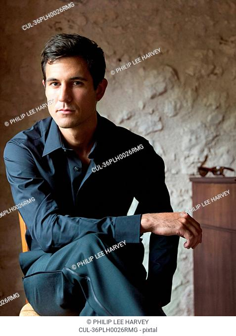 Businessman sitting with legs crossed