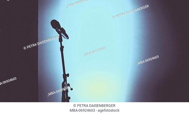 Colours on stage, light and show technology, the microphone - mystical, lonely, before the performance