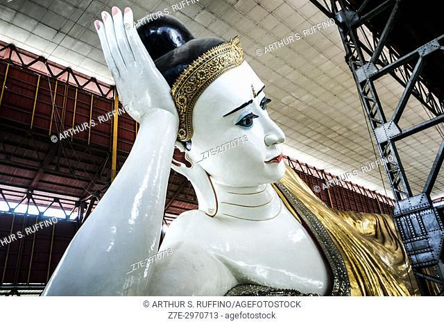 Angular view of the Buddha supporting his head on his right hand. Reclining Buddha, Chauk Htat Gyi Pagoda, Yangon, Myanmar