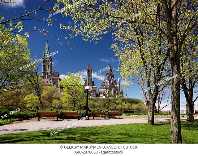 The Parliament Building view from a park in Ottawa, Ontario, Canada springtime daytime scenic May 2017