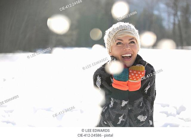 woman laughing in snow