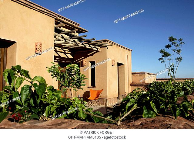 TERRACE AND GARDEN OF THE ECO-LODGES, DESIGNED IN PURE BERBER TRADITION WITH COMFORT AND RESPECT FOR THE ENVIRONMENT IN MIND, DOMAINE DE TERRES D'AMANAR