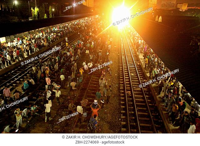 Passangers waiting for train at Airport Rail way station in Dhaka