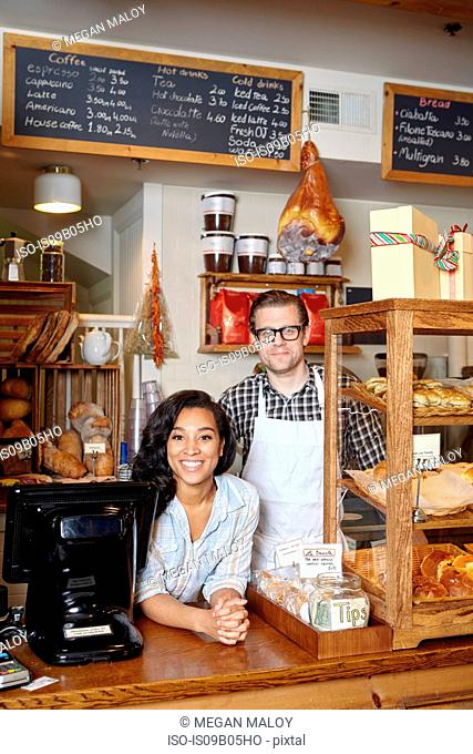 Portrait of male and female worker in bakery