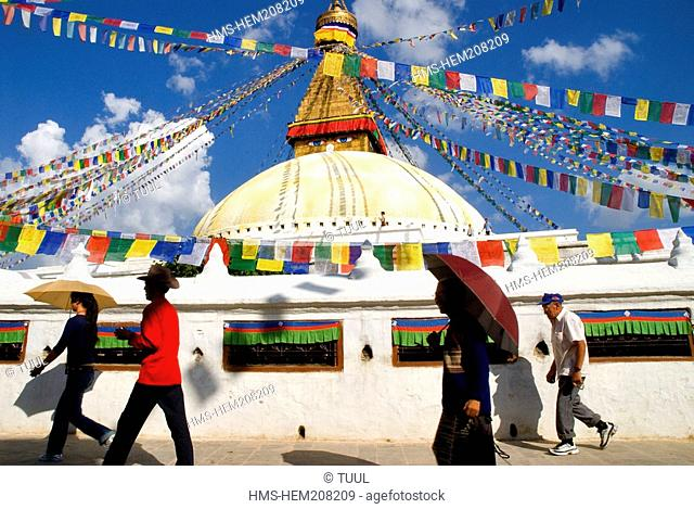 Nepal, Kathmandu Valley listed as World Heritage by UNESCO, Kathmandu, Bouddhanath Stupa, Tibetan pilgrims with umbrellas
