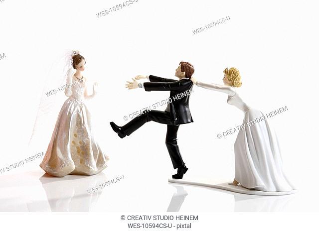 Escaping bride groom figurine