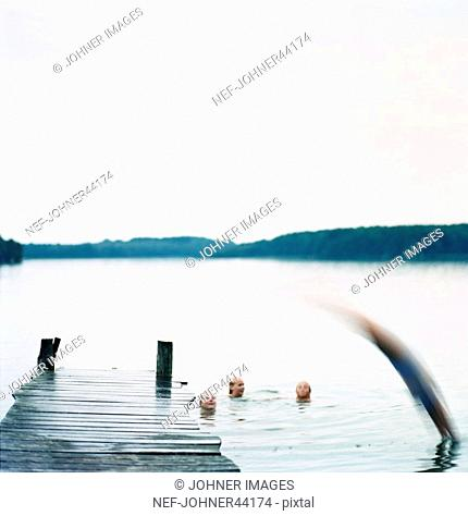 Blurred person jumping into water