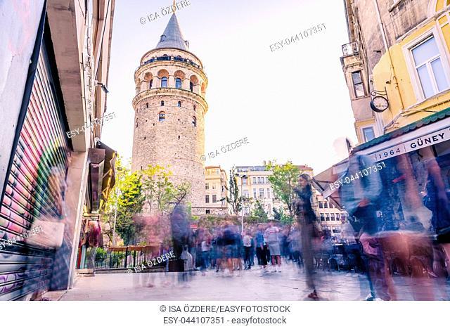 Unidentified people walk near Galata Tower,a medieval stone tower in the Galata,Karakoy,Istanbul,Turkey . 29 April 2018